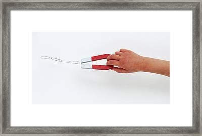 Hand Holding Horseshoe Magnet Framed Print by Dorling Kindersley/uig