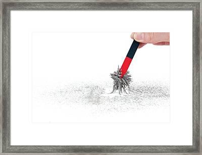 Hand Holding Magnet Framed Print by Dorling Kindersley/uig