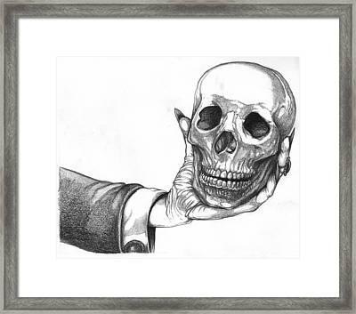 Hand Holding Skull Framed Print by Joseph Capuana