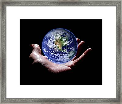 Hand Holding The Earth Framed Print by Victor De Schwanberg