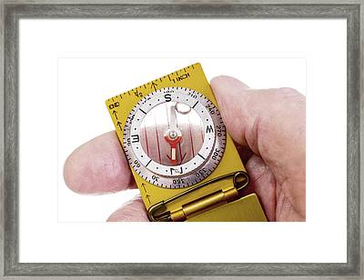 Hand Holding Vintage Compass Arrow Pointing North Framed Print