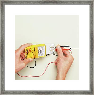 Hand Inserting Black And Red Wires Framed Print by Dorling Kindersley/uig