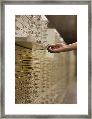 Hand Pulling Out Filing Drawerottawa Framed Print by Richard Desmarais