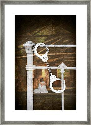 Handcuffs On Bed Framed Print by Amanda Elwell