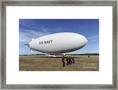 Handlers Prepare To Launch The Navys Framed Print by Stocktrek Images