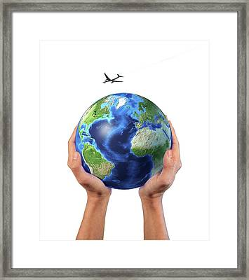 Hands Holding Globe With Aeroplane Framed Print by Leonello Calvetti