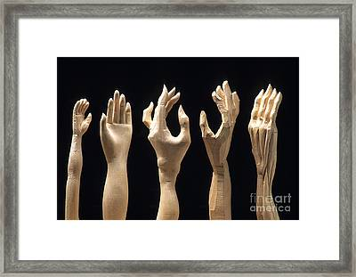 Hands Of Wood Puppets Framed Print