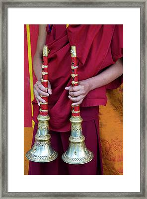 Hands Of Young Monk Holding Ceremonial Framed Print by Ellen Clark