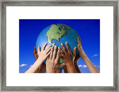 Hands On A Globe Framed Print