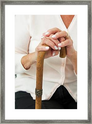 Hands On A Walking Stick Framed Print