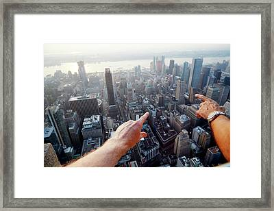 Hands Pointing At City As Seen From Framed Print by Chris Tobin