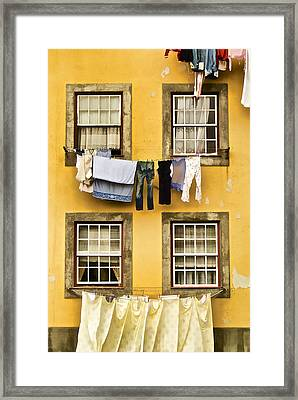 Hanging Clothes Of Old World Europe Framed Print