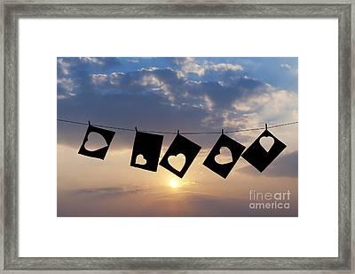 Hanging Hearts Framed Print