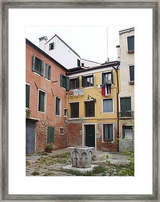 Hanging In The Courtyard  Framed Print