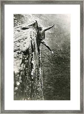 Hanging Off Cliff Framed Print by Retro Images Archive