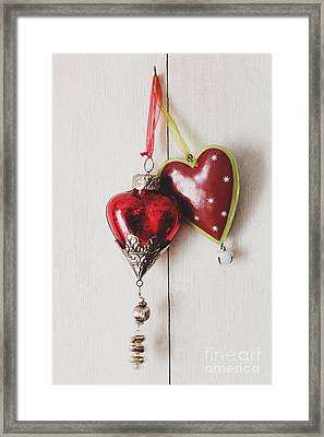 Framed Print featuring the photograph Hanging Ornaments On White Background by Sandra Cunningham