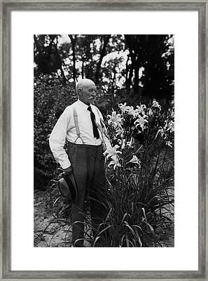 Hans Peter Sass Standing Beside A Flowering Plant Framed Print by Fleeta Brownell Woodroffe