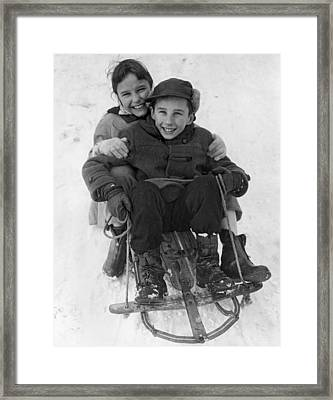 Happy Children On A Sled Framed Print by Underwood Archives