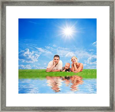 Happy Family Together On Grass Framed Print by Michal Bednarek