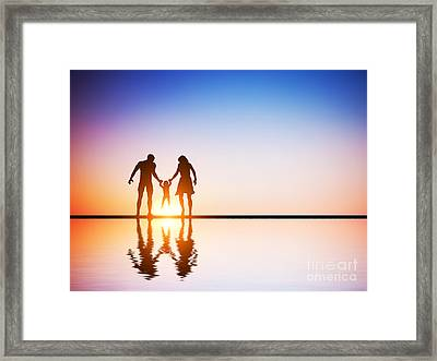 Happy Family Together Parents And Their Child At Sunset Framed Print