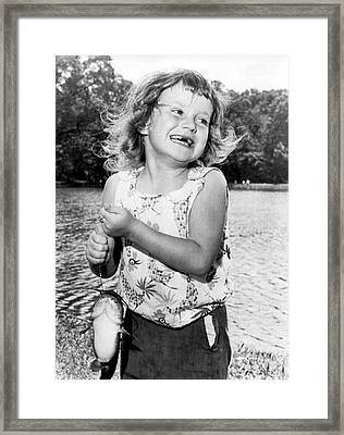 Happy Girl With Catfish Framed Print by Underwood Archives