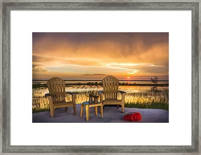 Happy Hour At The Lake Framed Print by Debra and Dave Vanderlaan