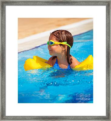 Happy Little Girl In The Pool Framed Print by Anna Om