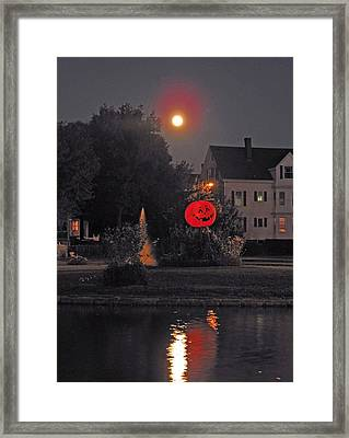 Happy Pumpkin At The Pond Framed Print