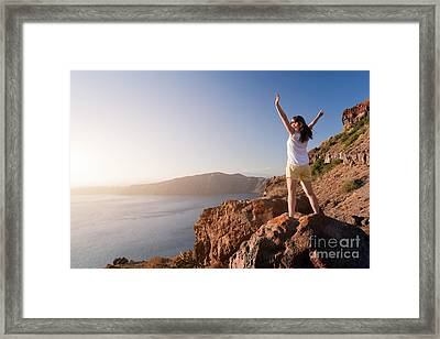 Happy Woman On The Rock With Hands Up Framed Print