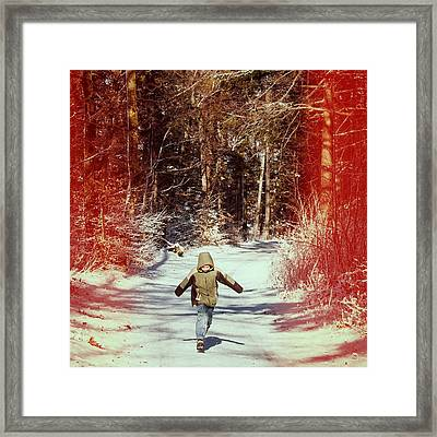 Happy Young Boy Running In The Winterly Forest Framed Print