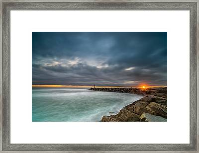 Harbor Jetty Sunset Framed Print by Larry Marshall