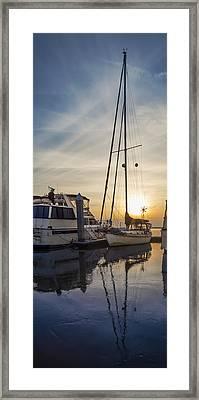 Harbor Light Framed Print by Debra and Dave Vanderlaan