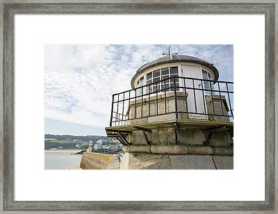 Harbour Wall And Lighthouse In St Ives Framed Print by Ashley Cooper