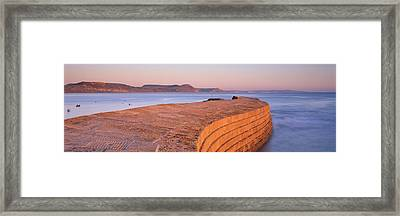 Harbour Wall At Dusk, The Cobb, Lyme Framed Print by Panoramic Images