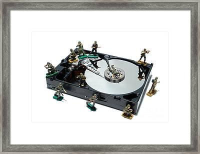 Hard Drive Defense  Framed Print by Olivier Le Queinec