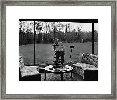 Harold M Sloan Cleaning A Glass Wall Framed Print by  Hedrich-Blessing