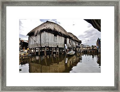 Hats On Water Framed Print by Manu G