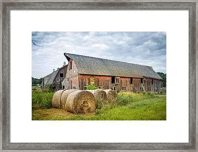 Hay Bales And Old Barns Framed Print