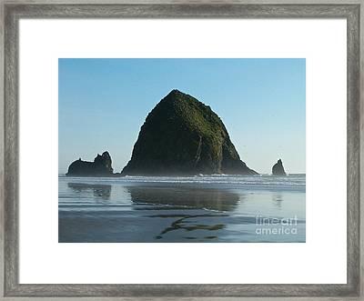 Haystack Rock Framed Print by Elton Leung
