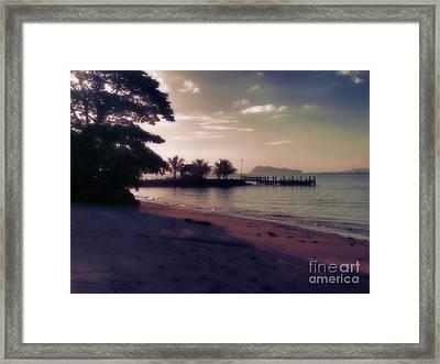 Hazey Samoan Sunset Framed Print by Karen Lewis