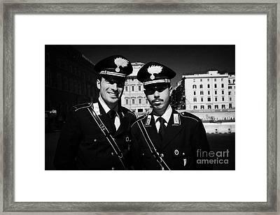 head and shoulders of Two Arma Dei Carabinieri Italian police officers on duty in Piazza Venezia Rom Framed Print