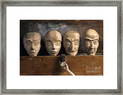Heads Of Wooden Puppets Framed Print