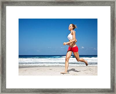 Healthy Woman Running On The Beach Framed Print by Anna Om