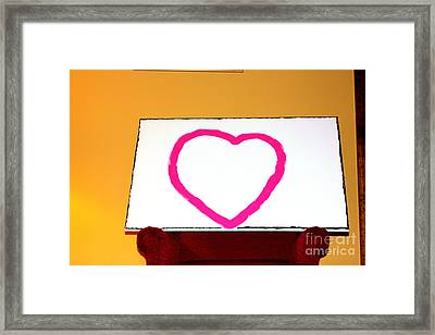 Heart And A Red Chair Framed Print