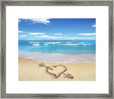 Heart Shape On Sandy Beach Framed Print by Leonello Calvetti
