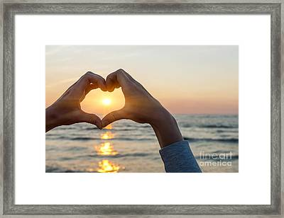 Heart Shaped Hands Framing Ocean Sunset Framed Print by Elena Elisseeva
