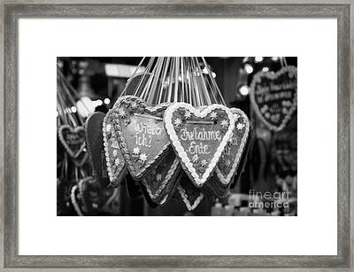 heart shaped Lebkuchen hanging on a christmas market stall in Berlin Germany Framed Print