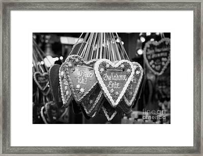 heart shaped Lebkuchen hanging on a christmas market stall in Berlin Germany Framed Print by Joe Fox