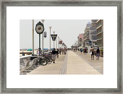 Heat Waves Make The Boardwalk Shimmer In The Distance Framed Print