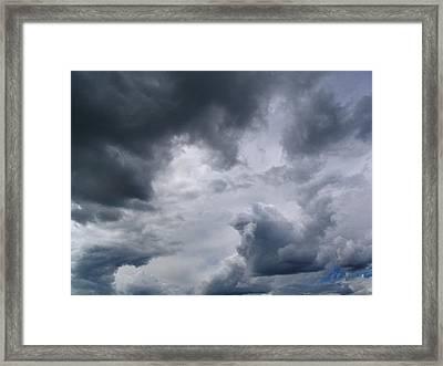 Heaven Looks Angry Framed Print